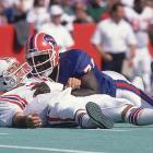 Smith takes down Patriots QB Doug Flutie on Oct. 1.