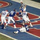 Smith sacks Giants QB Jeff Hostetler for a safety in Super Bowl XXV. Despite Smith's efforts, the Bills lost, 20-19.