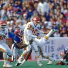 Smith pursues Chiefs QB Joe Montana during a 44-10 victory. Smith had two sacks in the game.
