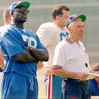 Recovering from shoulder surgery, Smith looks on with head coach Marv Levy during the first practice of training camp.