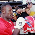 Smith signs autographs for young fans after a practice for the 1996 Pro Bowl on Jan. 31.