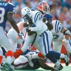 Smith halts Colts RB Marshall Faulk's progress on one of his 1,078 career tackles.