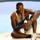 Bruce Smith poses by the pool in a Virginia Beach photo shoot.