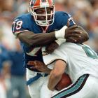 Jaguars QB Mark Brunell experiences the full force of one of Smith's 200 career sacks.