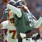 The Redskins defensive end Bruce Smith makes a sack on Eagles quarterback Donovan McNabb at Veterans Stadium.