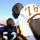Smith speaks with Ray Lewis before a game on Oct. 15.