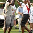 Bruce Smith and Michael Strahan participate in Strahan's charity golf tournament.