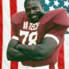 <italics>The Hall of Fame defensive end out of Virginia Tech turned 50 years old on June 18, 2013. The first overall pick of the 1985 NFL draft, Bruce Smith is the league's all-tme sacks leader with 200. In his 19-year career (15 with Buffalo, 4 with Washington), Smith made 11 Pro Bowls and was an 8-time First-Team All-Pro.</italics> Bruce Smith had an all-state high school career at Booker T. Washington High School, and received an athletic scholarship to play at Virginia Tech. Smith was selected for the All-America Team in 1984.
