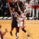 The Spurs' Kawhi Leonard throws down an emphatic slam over the Heat's Mike Miller. Leonard finished with 22 points and 11 rebounds.