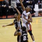 Miami's Chris Bosh (right) attempts a put-back over San Antonio's Tim Duncan and Kawhi Leonard.