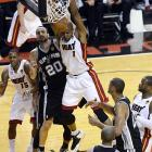 Miami's Chris Bosh (1) finishes past San Antonio's Manu Ginobili. Bosh totaled 10 points and 11 rebounds in 39 minutes.