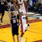 The Spurs' Tony Parker pulls up for a jumper over the outstretched arms of the Heat's Mario Chalmers.