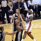 Miami's LeBron James floats a jumper over San Antonio's Boris Diaw.