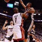 San Antonio's Tim Duncan finishes with an aggressive dunk.