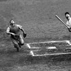 Gehrig hits a foul ball as he plays despite a fractured thumb, extending his streak to 2,045 consecutive games on July 19, 1938.