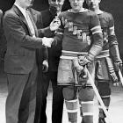 Gehrig, at this point 1,307 games into his 2,130 consecutive game streak, presents a ring to the New York Rangers' Murray Murdoch in Jan. 1934, who had played in all 400 Rangers games.