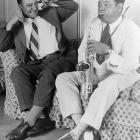 Lou Gehrig plugs his ears as Babe Ruth blows into a saxophone during a photo opportunity stunt in 1928.