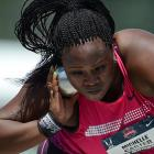 Michelle Carter, the daughter of former NFL nose tackle Michael Carter, won the shot put. She set an American record in the process, with a throw of 66 feet, 5 inches.