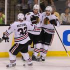 Michal Rozsival and Patrick Kane congratulated Jonathan Toews after his second-period goal tied the game at 1-1.