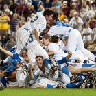 The UCLA Bruins dogpile to celebrate their NCAA College World Series win after defeating Mississippi State, 8-0, in the second game of the best-of-three matchup. UCLA took the series, 2-0.