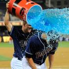 Eric Stults is doused by teammate NIck Hundley following the Padres 2-1 win over the Diamondbacks. Stults threw a career-best two-hitter while earning the win.