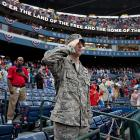Georgia National Guard Lt. Col. Keith Filer salutes during the playing of the National Anthem before the start of the Braves and Marlins at Turner Field.
