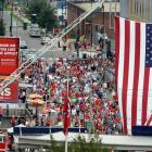 Fans pour into Nationals Park in Washington D.C. with a large American flag unfurled outside of the stadium.