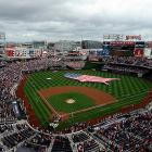 Nationals Park stands for the national anthem before a game between the Nationals and Brewers.