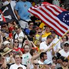 Fans wave flags and celebrate during the Pirates-Phillies game on Thursday.