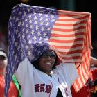 One Red Sox fan hoists an American flag during their July 4 game against the Padres.