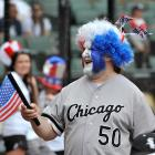 A White Sox fan shows off all kinds of red, white and blue. Luckily for him, he would watch the White Sox win in the ninth inning.