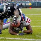 Osi Umenyiora got the first start of his NFL career in his only Birthday Game. The 22-year-old rookie out of Troy (No. 72) couldn't stop Brian Westbrook from scoring on this play, though, and was credited with only one tackle in the 28-10 loss to the Eagles.
