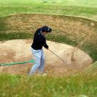 The United States' Hunter Mahan drives a ball from the bunker in Scotland on July 15.