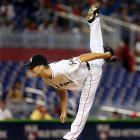 Miami Marlins starter Jacob Turner follows through on a pitch against the Atlanta Braves on July 10 in Miami.