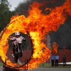 An Indian army soldier jumps through a flaming hoop on a motorcycle as part of a celebration in Hyderabad, India on July 14.