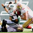 Justin Smith spent his 33rd birthday teeing off on Mark Sanchez and recovering this fumble during a 34-0 victory. The defensive end notched the first sack of his career on his first Birthday Game, a takedown of Doug Flutie in 2001.