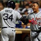 David Ortiz congratulates Cabrera after he scored the AL's first run.