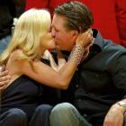 Phil and Amy kiss while in attendance for Game Five of the Western Conference Semifinals between the Rockets and Lakers in Los Angeles.