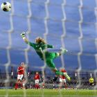 Louisa Necib scores France's second goal past England goalkeeper Karen Bardsley during the 2013 UEFA Women's European Cup in Linkoping, Sweden. France won 3-0.