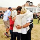 Phil Mickelson hugs his wife, Amy, and children Evan, Amanda and Sophia after the final round of the 142nd Open Championship at Muirfield. Lefty finished the day with a 66 and a three-stroke victory to win his first British Open.