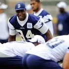 Dallas Cowbows linebacker DeMarcus Ware prepares to get past the offensive linemen as they run plays without pads.