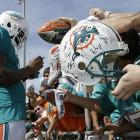 Miami Dolphins wide receiver Mike Wallace signs autographs for fans.