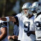 Dallas Cowboys quarterback Tony Romo (9) and wide receiver Dez Bryant discuss a play