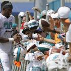 Miami Dolphins cornerback Will Davis interacts with fans after practice at training camp in Davie, Fla.
