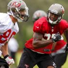 Tampa Bay Buccaneers cornerback Johnthan Banks (right) covers wide receiver Chris Owusu during camp.