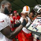Tampa Bay Buccaneers' Mike Williams signs autographs for fans.