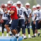 In addition to his quarterback reps as camp opened, Tebow also caught passes and lined up with receivers and backs in other drills.