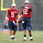 The Patriots opened camp with the Aaron Hernandez case on everyone's mind and the addition of Tim Tebow to deal with too.