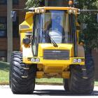 Pittsburgh Steelers defensive end Brett Keisel drives an off-road dump truck up the driveway towards the team dormitories as he arrives for the start of camp.
