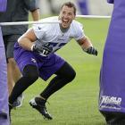 Minnesota Vikings linebacker Chad Greenway reacts as he runs a drill in Mankato, Minn.
